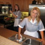 Two Maids Cleaning Kitchen